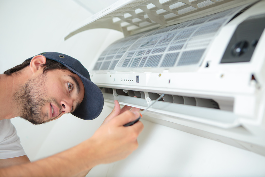 Man working on air conditioning unit